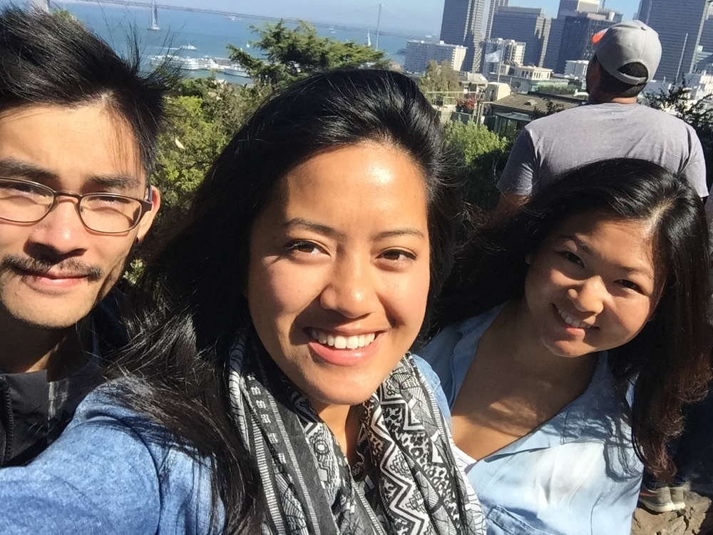 We trekked up stairs and hills to get to  Coit Tower ! You can see the view a bit, but I highly recommend you visit this place yourself to see it. In the meantime here are our faces with the San Franbrisky wind blowing our hair.