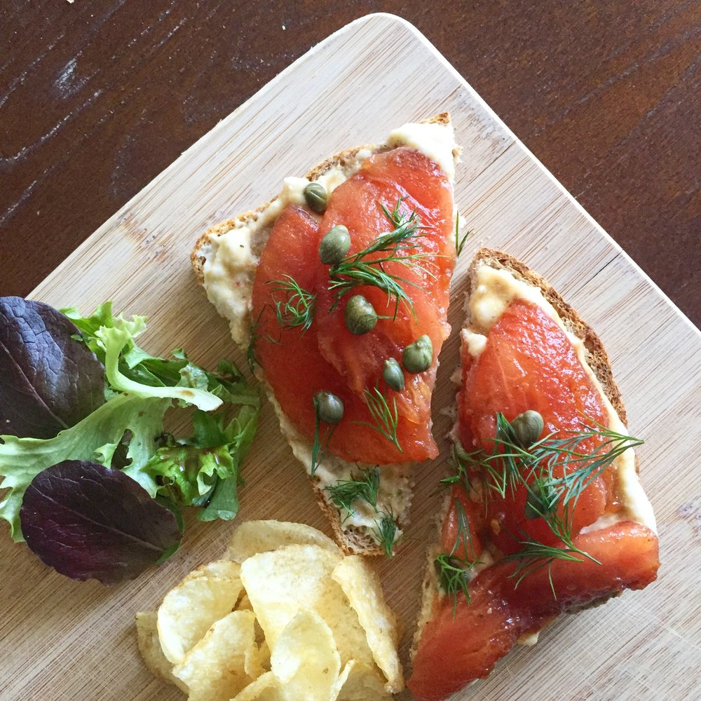 Vegan take on salmon lox. This is actually boiled tomato slices marinated in smoked olive oil, nori and salt.