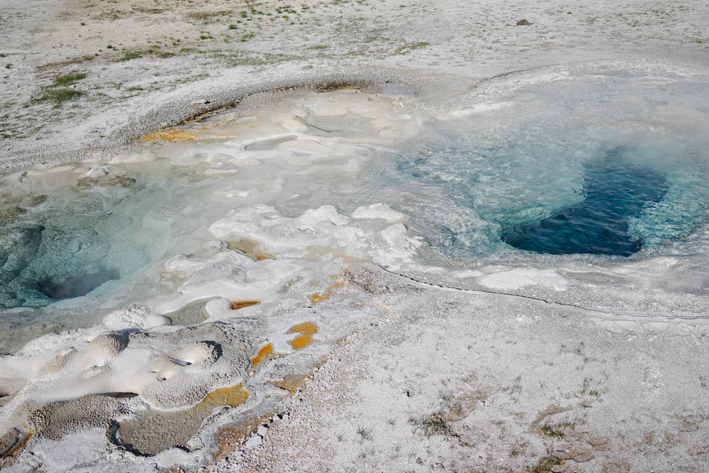 SPASMODIC GEYSER  Two craters make up the geyser and is named because of its erratic eruptions. Irregular eruptions occur from both craters and can go up to 15 feet (4 m) high. It has a temperature of 198°F (92°C).