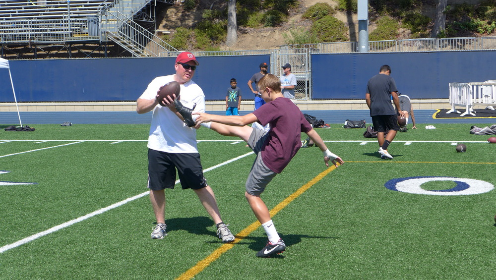 kicking1on1 instructor paul stonehouse working with mater dei punter/kicker ryan stonehouse