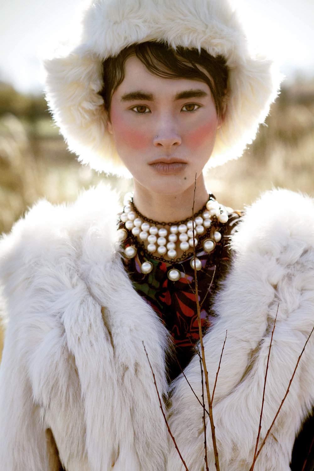Dress by Carmelita Couture; Fur by Teranchula Couture; Fur Hat by Ke Collection