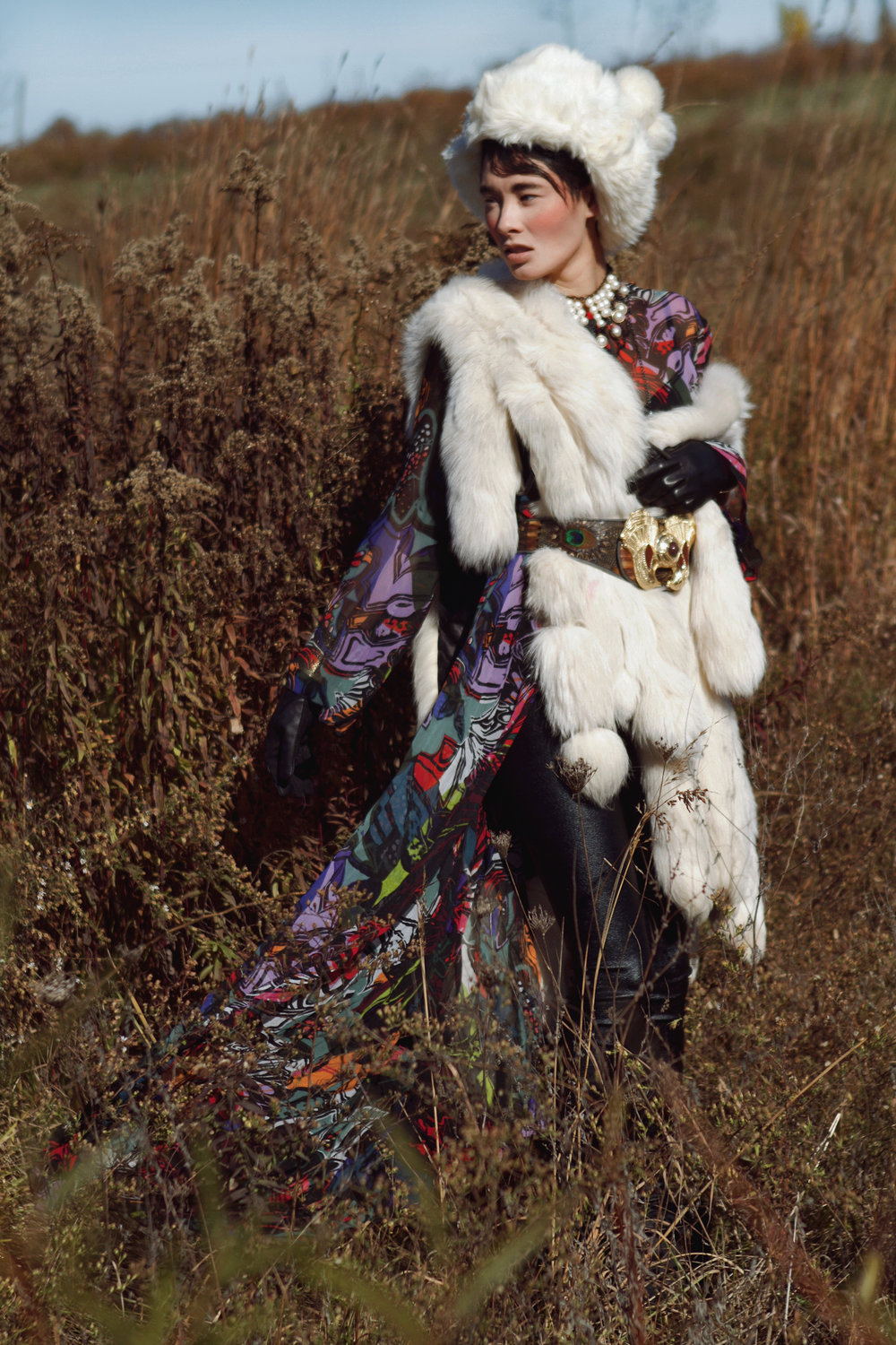 Dress by Carmelita Couture; Fur and leather tights by Teranchula Couture; Fur Hat by Ke Collection