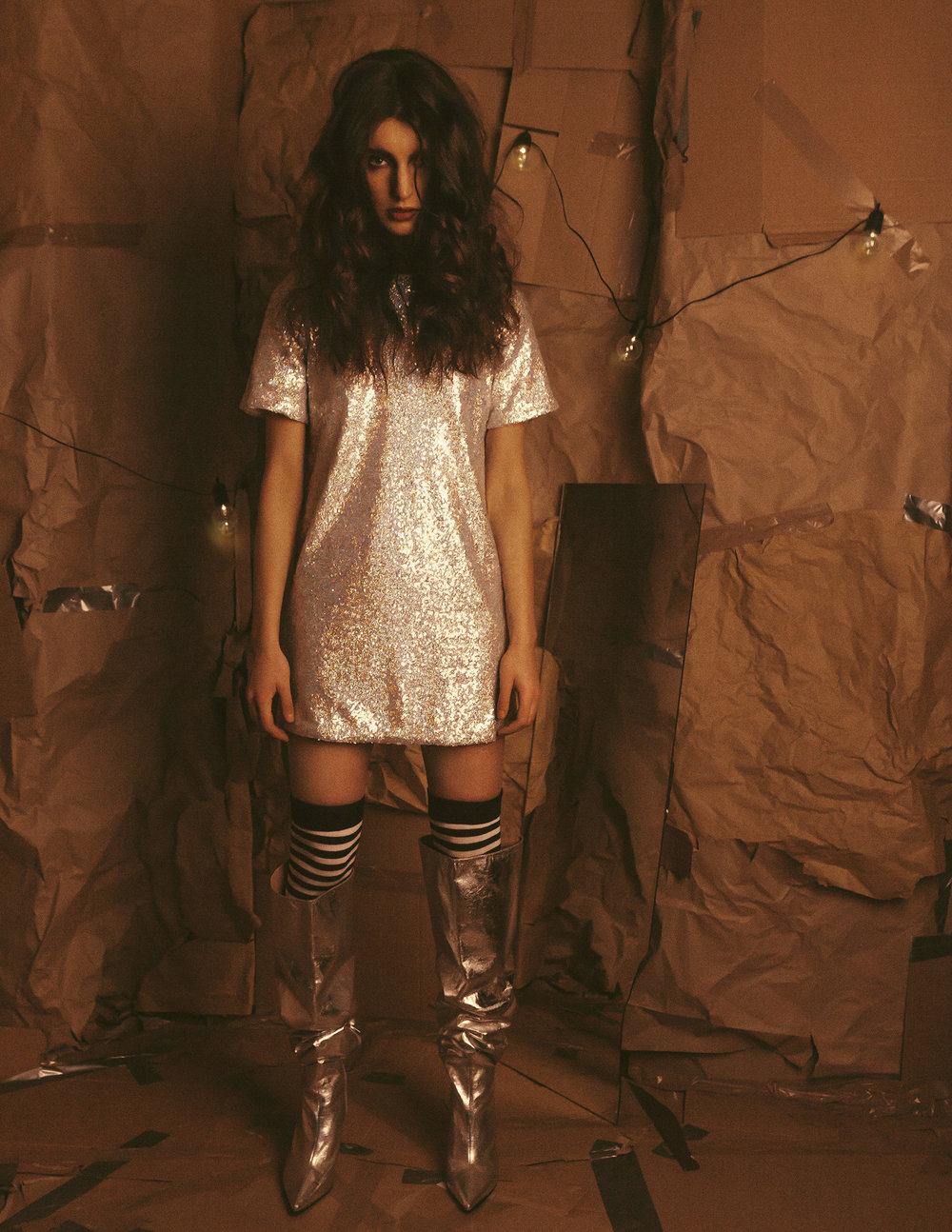 Sequin T-shirt dress stylist's own Stripe over the knee socks stylist's own Silver over the knee boots Zara