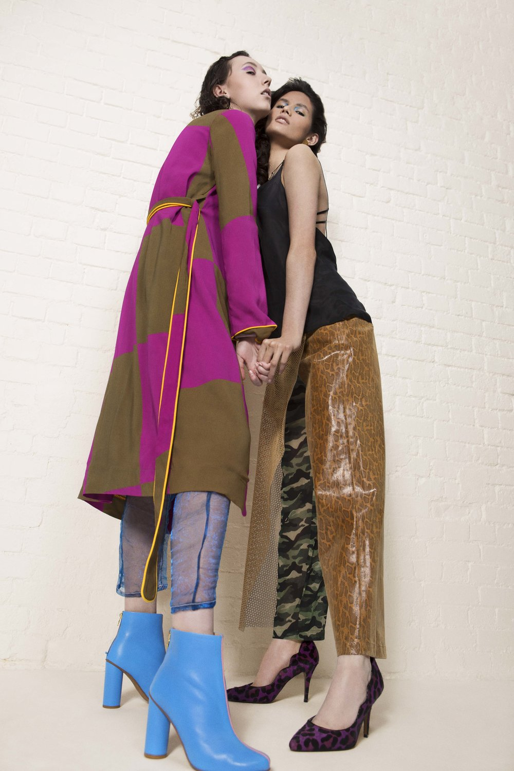 Antonie (Left) Jumper – URBAN SOPHISTICATION Overcoat – STINE GOYA Pants – FAUSTINE STEINMETZ (YOUNG BRITISH DESIGNERS) Footwear – STINE GOYA  Sara (Right) Top – TRAMP IN DISGUISE Pants – DANS LA VIE Earring – JOANNA CAVE (YOUNG BRITISH DESIGNERS) Necklace – VAN PETERSON Footwear -  ROKIT