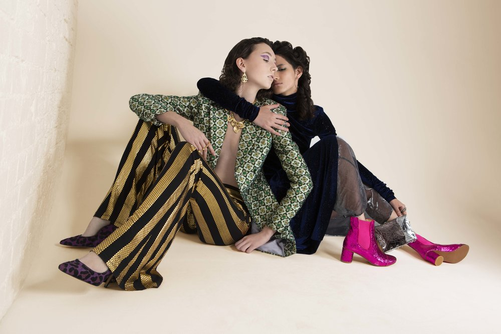 Anotonie (left)  Blazer – FANTOME MALAN BRETON Pants –  JIRI KALFAR Earring – EKRIA Bracelet – VAN PETERSON Neckpiece – STELLA & DOT Footwear – ROKIT   Sara (Right) : Dress – LES ANIMAUX Pants – TRAMP IN DISGUISE Earring – EKRIA Ring - EKRIA Bag – FLORENCE BRIDGE (YOUNG BRITISH DESIGNERS) Footwear – STINE GOYA