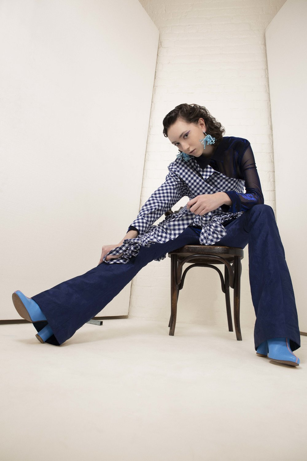 Shirt – TRAMP IN DISGUISE Top – LES ANIMAUX Pants – MALAN BRETON Earring – KRISTY WARD (YOUNG BRITISH DESIGNERS) Footwear – STINE GOYA