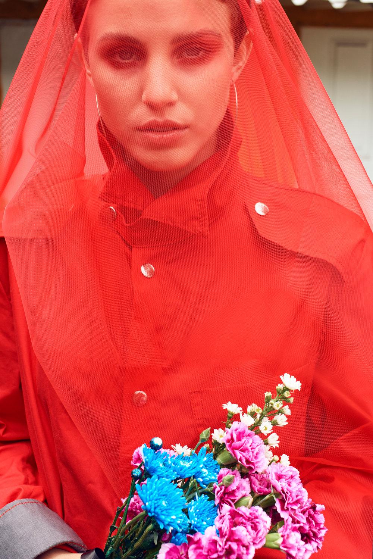 Delfina wearing Shirt - Manov , Earrings - Zara