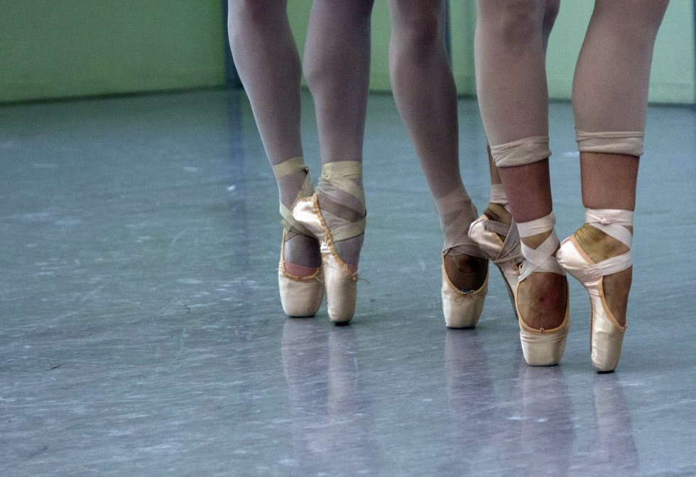 Ballet dancers frequently suffer dance-related injuries to their backs, knees and ankles.    Credit: Oregon Ballet Theatre's principal dancers- Beth Nakamura