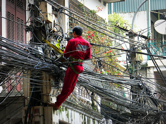 """Photo Credit: Marco Sarli, """"Hanoi. Solution? Add one more cable to the chaos."""" Flikr Creative Commons"""