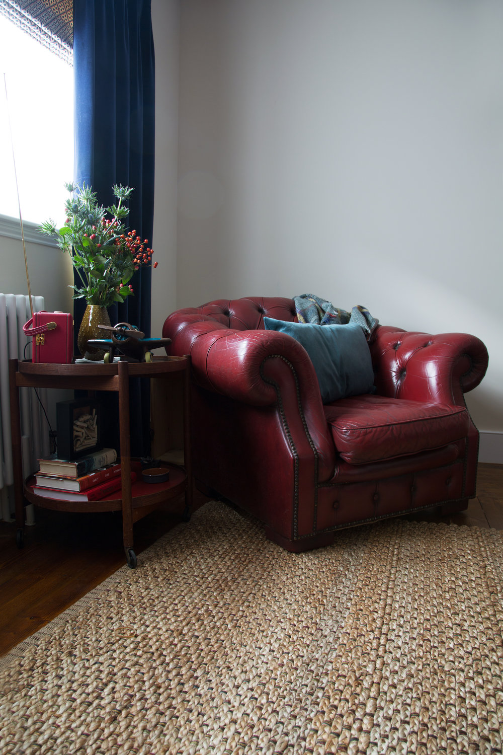 A Cosy Red Armchair in a Reading Nook in a Grade II Listed Holiday Home in Battle East Sussex – Interior Design by Smartstyle Interiors