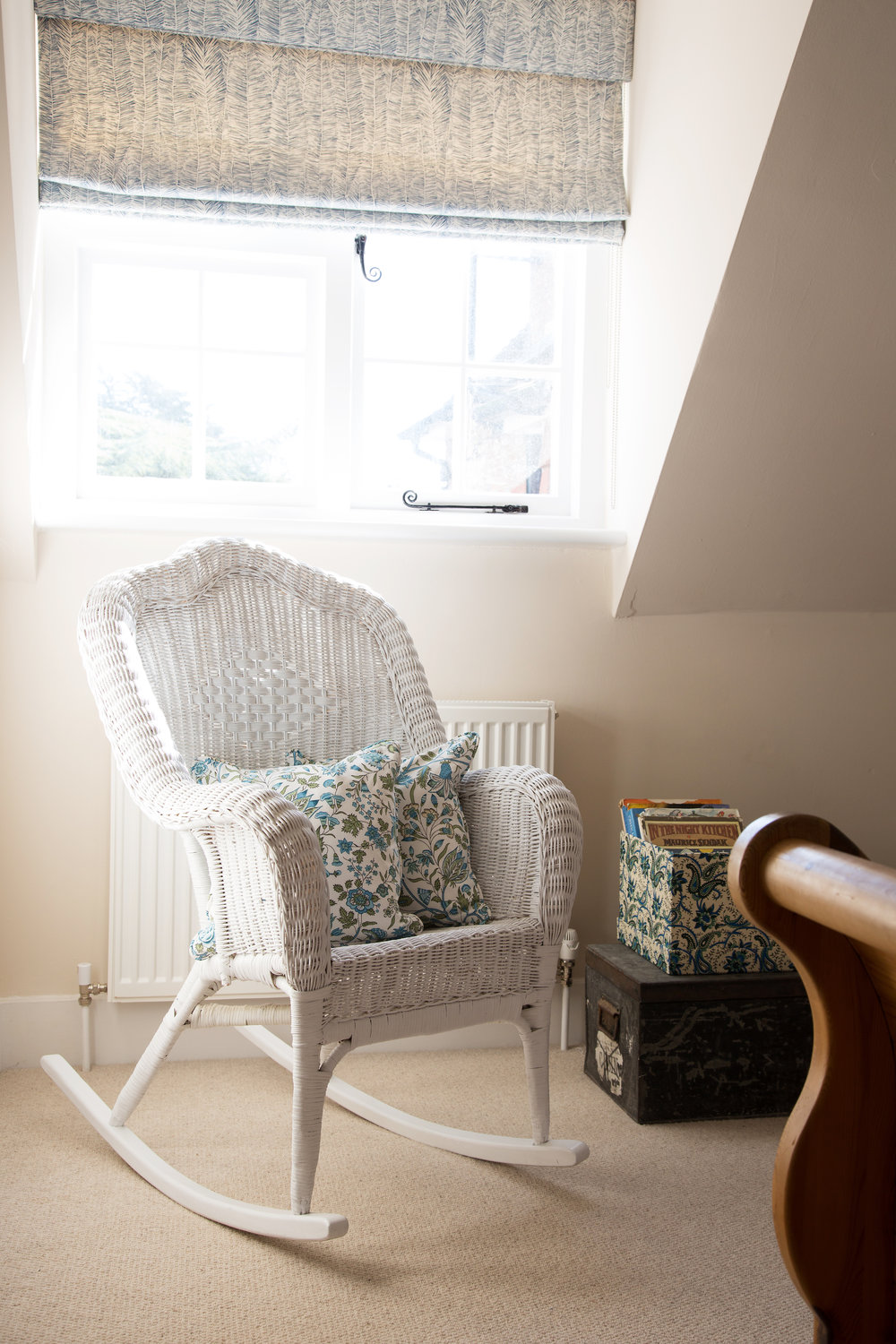 A Wicker Rocking Chair in a Bright Bedroom in a Grade II Listed Holiday Home in Battle East Sussex – Interior Design by Smartstyle Interiors