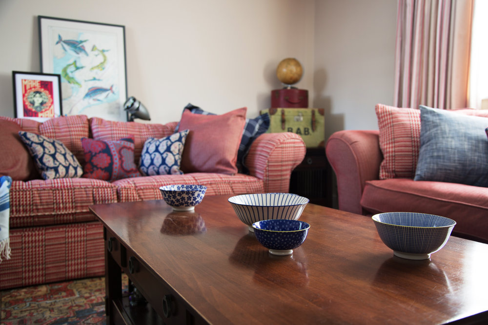 Blue Bowls in a Relaxing Red Living Room in a Cosy Grade II Listed Holiday Home in battle East Sussex – Interior Design by Smartstyle Interiors