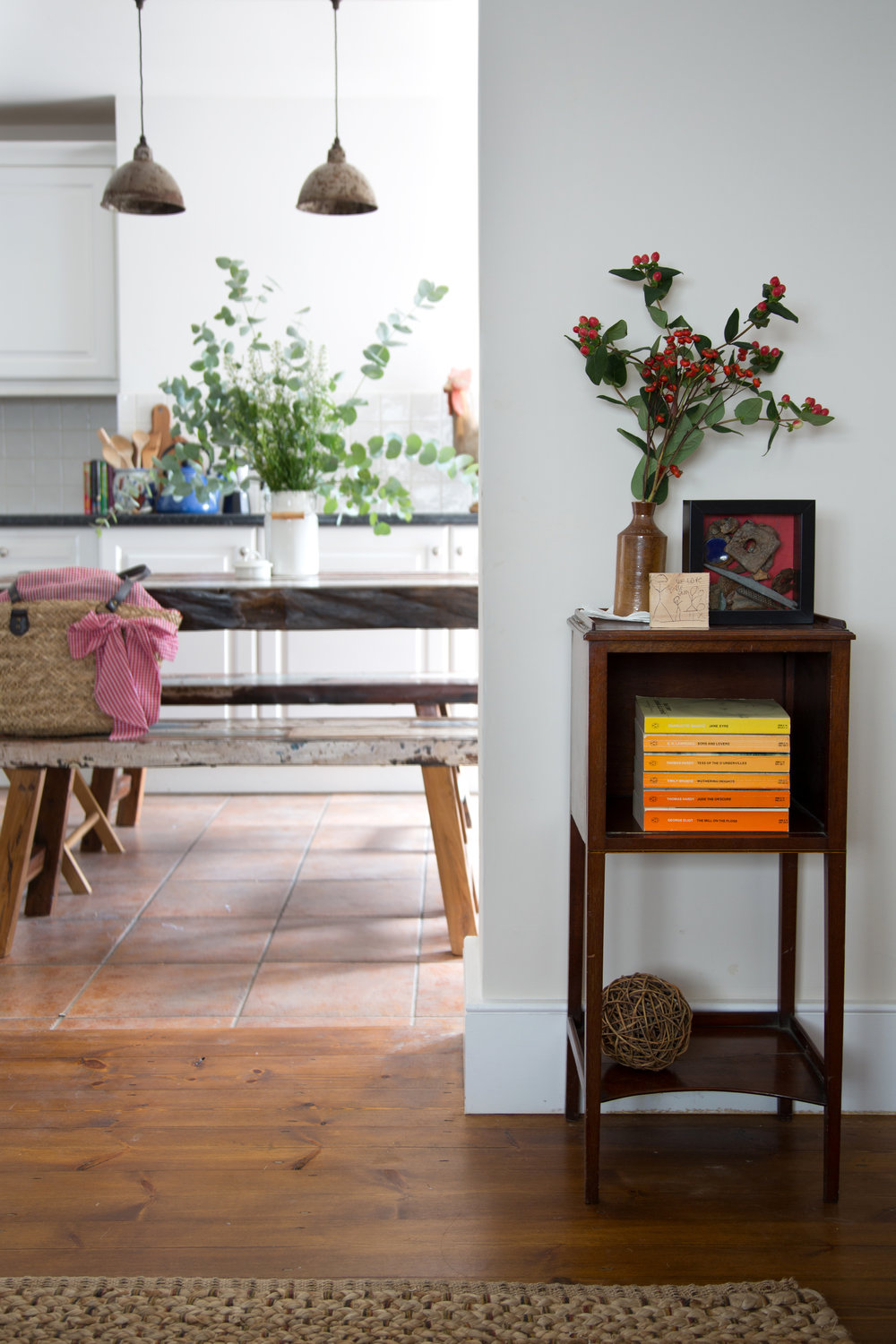 An Antique End Table off a Bright Kitchen in a Grade II Listed Home in Battle East Sussex – Interior Design by Smartstyle Interiors