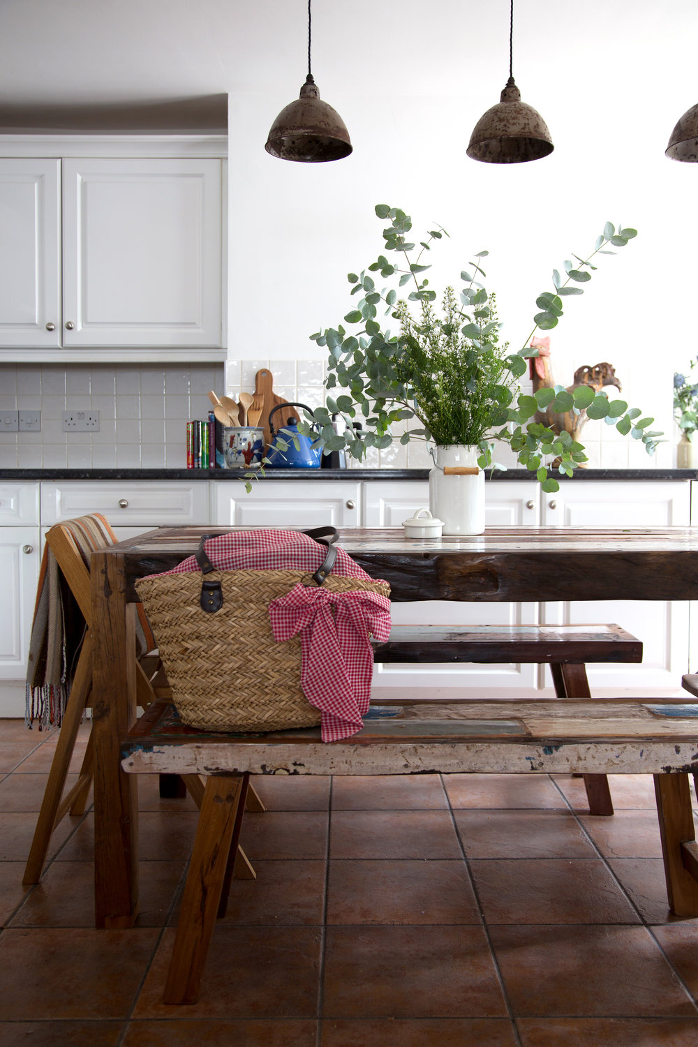 A Bright White Kitchen with a Rustic Wooden Table in a Grade II Listed Holiday Home in Battle East Sussex – Interior Design by Smartstyle Interiors
