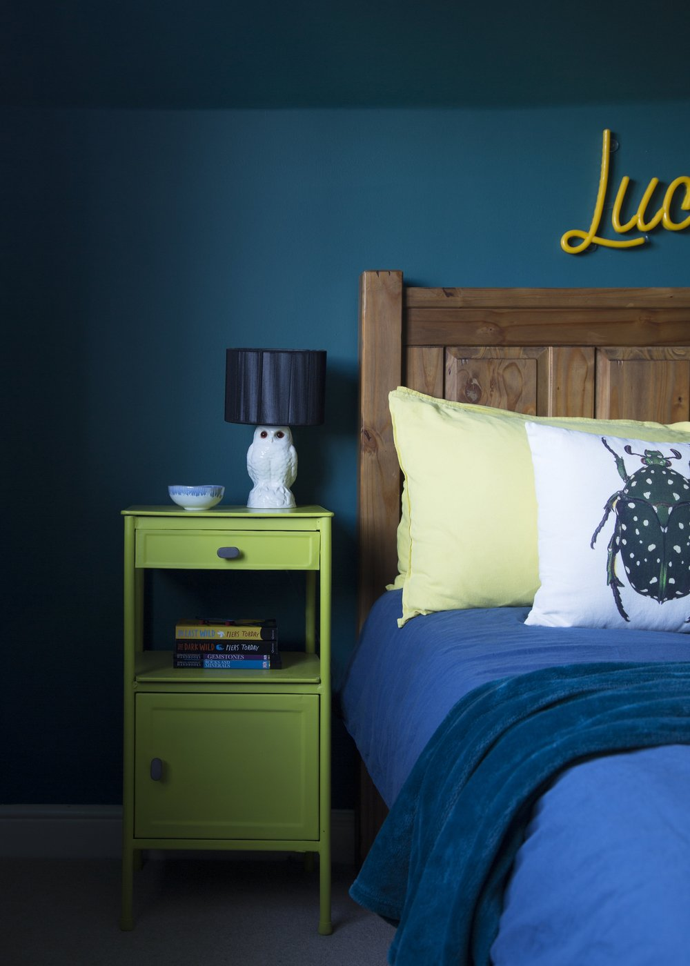A custom-made neon name sign from Love Inc hangs above the bed in this tweenager's room in Tunbridge Wells Kent - Interior Design by Smartstyle Interiors.jpg