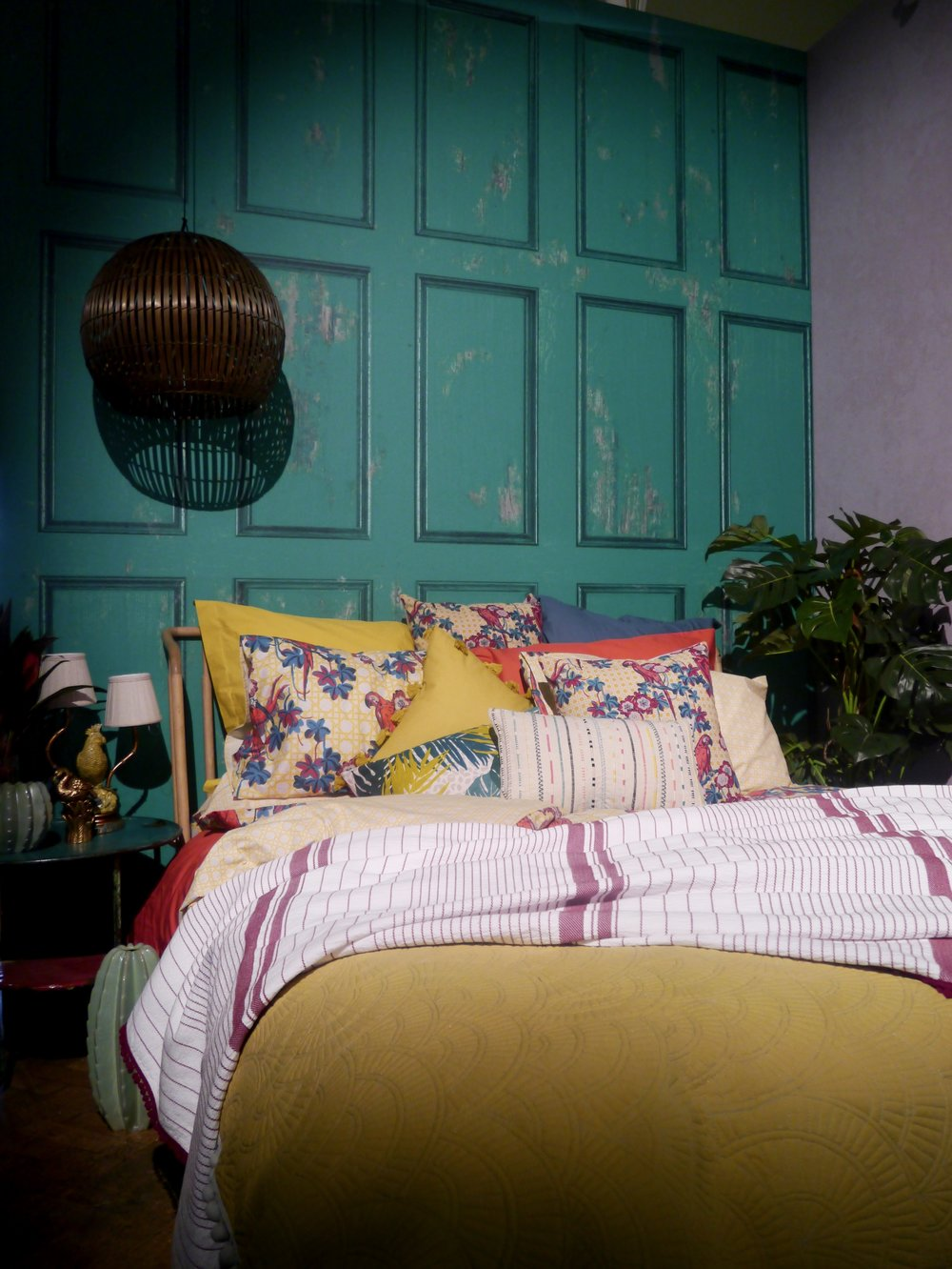Stunning yellow bedding at House of Fraser incorporates striped throws and floral pillows - Spring Design Trends - Phoebe Oldrey Interior Design .jpg