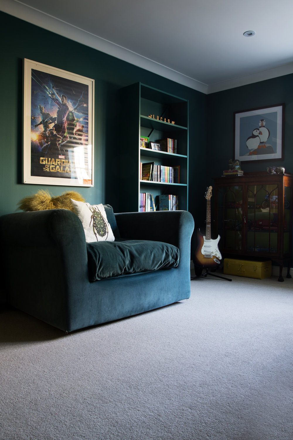 A teal sofa from Habitat in a tweenager's teal bedroom in Tunbridge Wells Kent - Interior Design by Phoebe Oldrey.jpg
