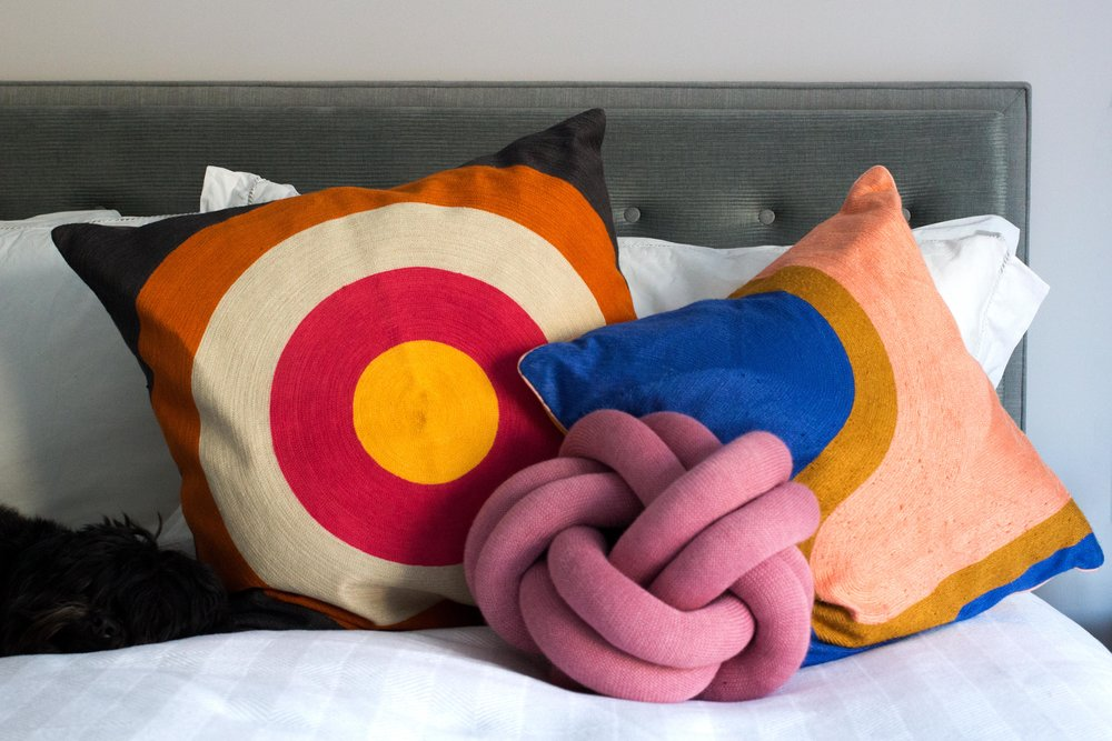 The-Bullseye-Cushion-and-the-Zoe-Cushion-from-Habitats-SS17-collection-bring-colour-to-a-blue-headboard-Phoebe-Oldrey-Interior-Design