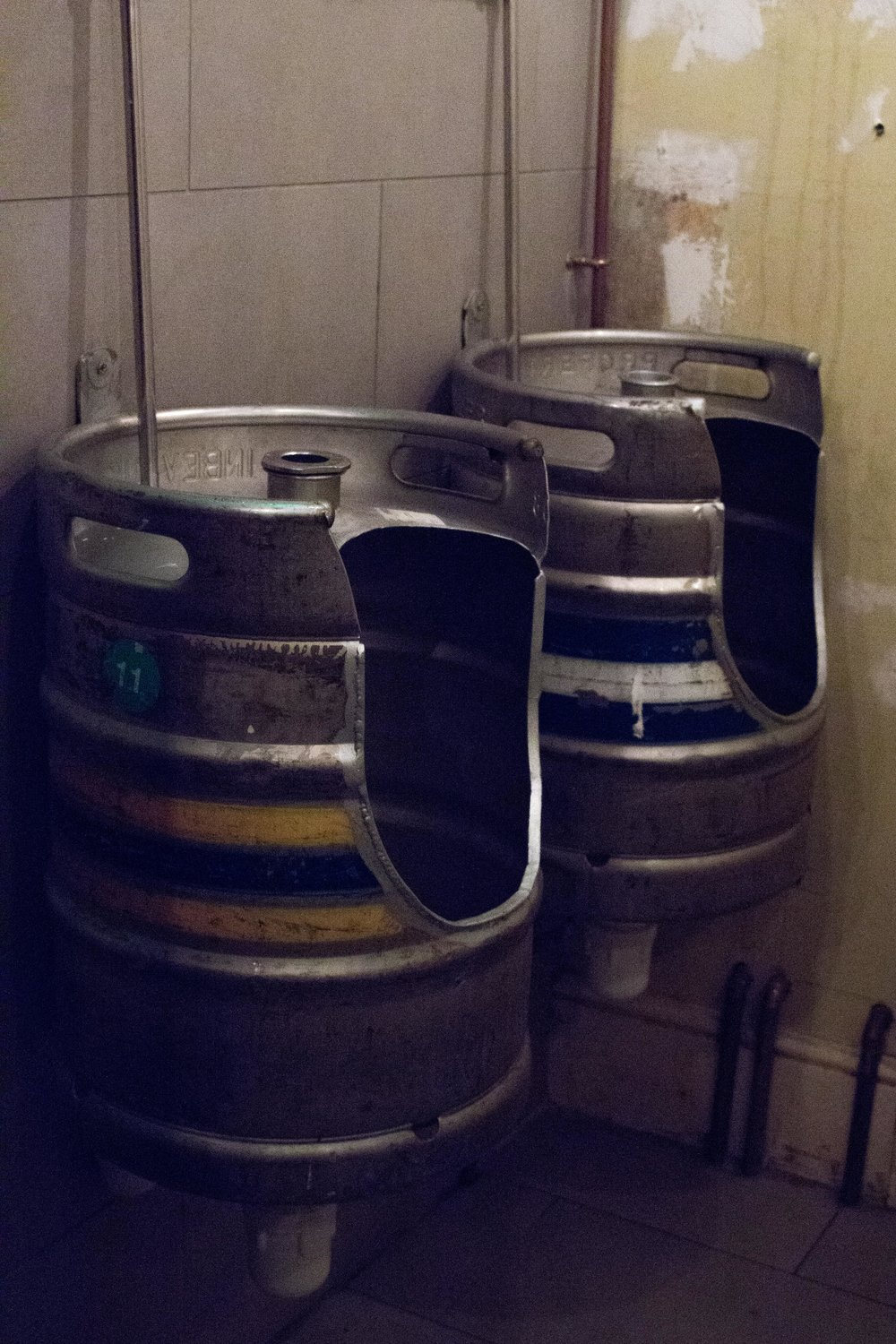 Framptons in Tunbridge Wells - Beer barrels are cleverly repurposed as urinals in the men's loo – Phoebe Oldrey Interior Design.jpg