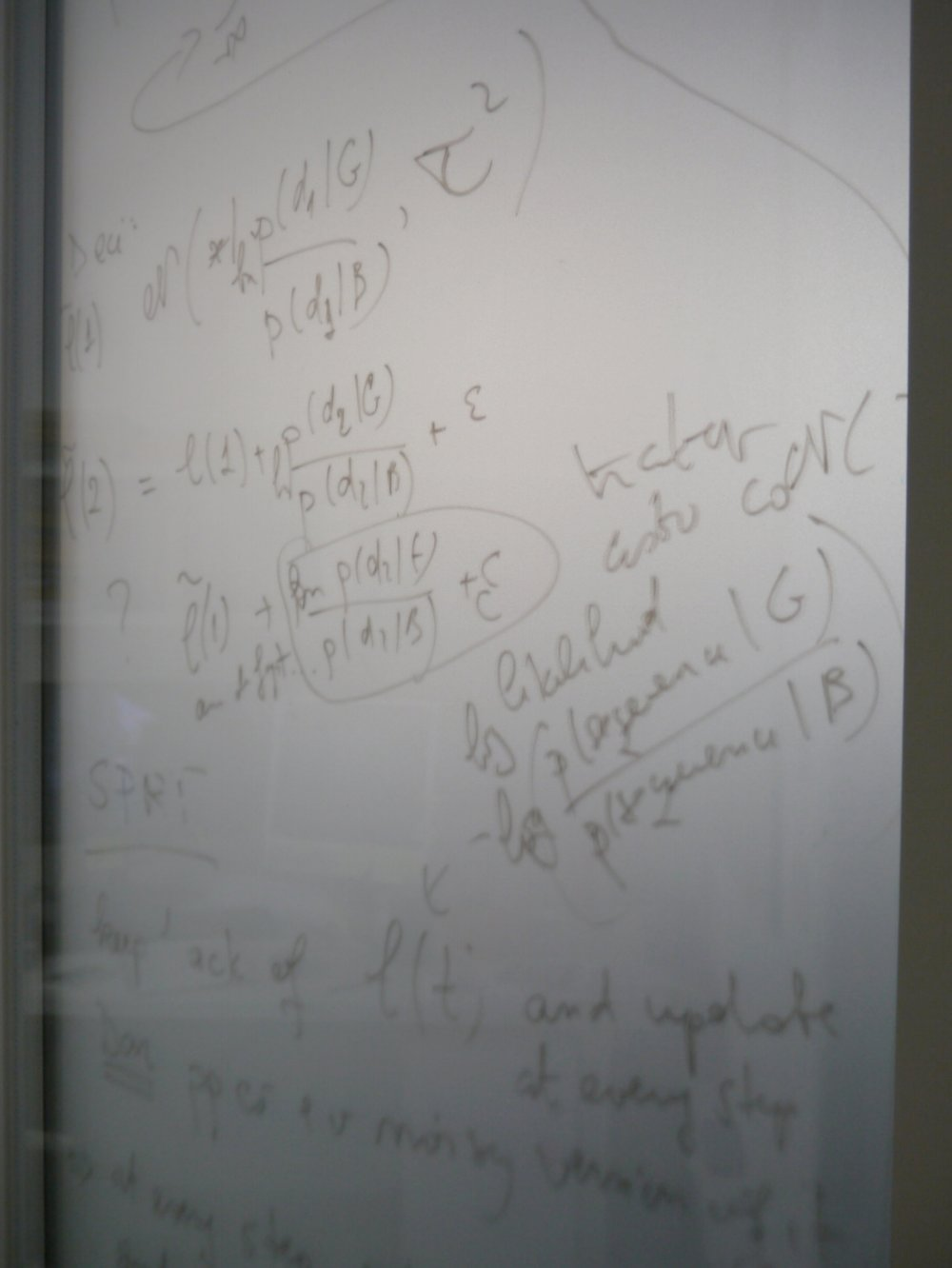 Equations are written across the door of an office in The Sainsbury Wellcoem Centre