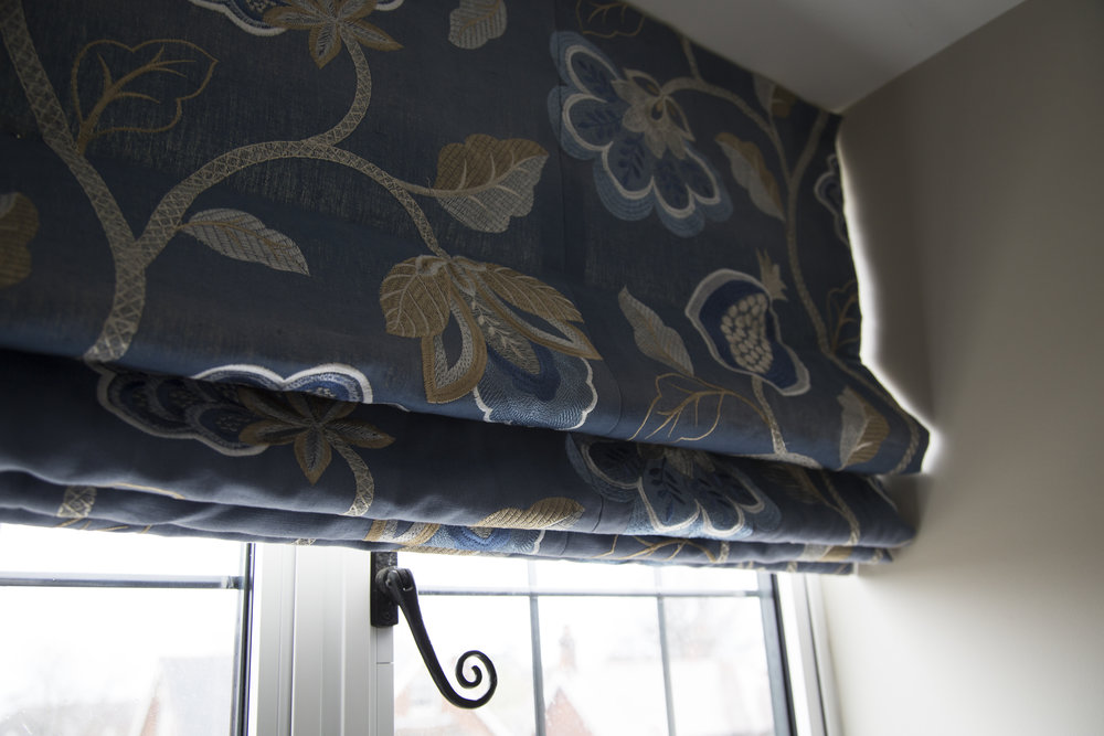 Bespoke Roman blinds in blue printed fabric were used in the master bedroom of this home in Sevenoaks Kent - Interior Design by Phoebe Oldrey