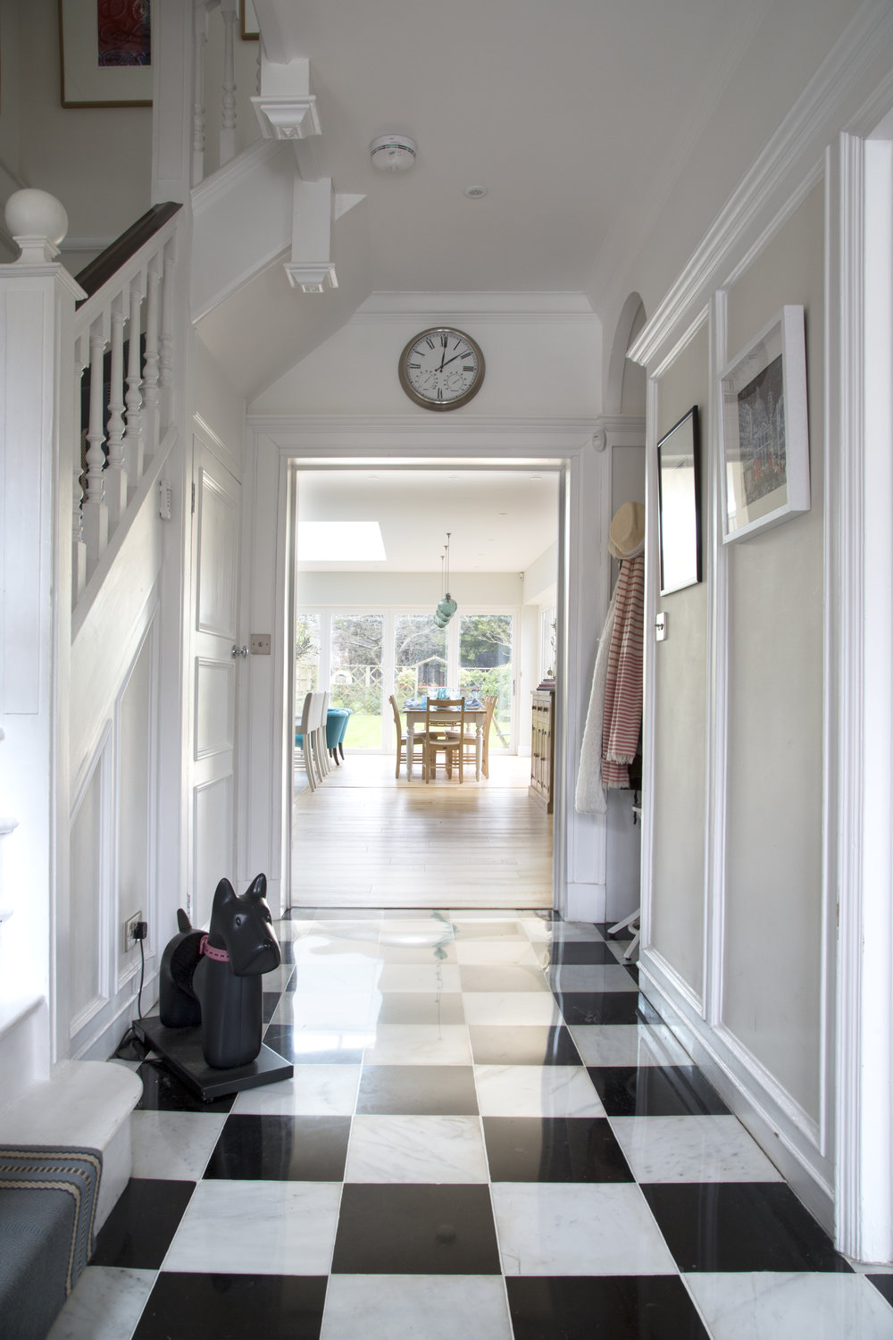 Black and white tiling leads into a sunny kitchen extension in Sevenoaks Kent - Interior Design by Phoebe Oldrey of Smartstyle Interiors