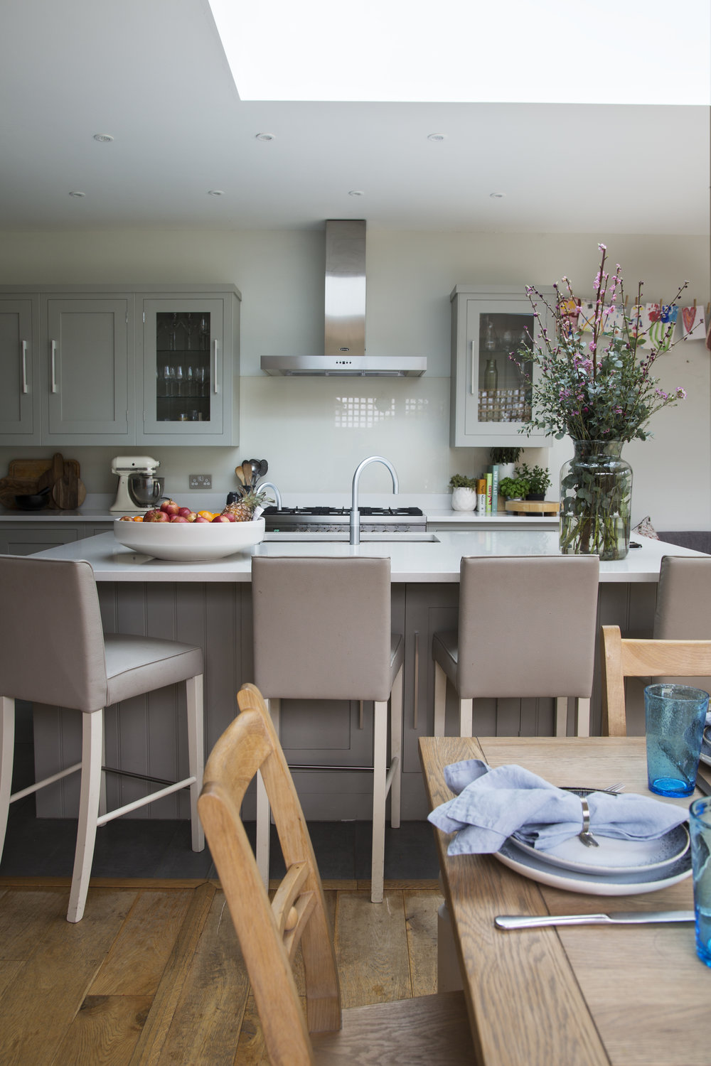 A large island in a sunny grey shaker style kitchen extension in Sevenoaks Kent - Interior Design by Phoebe Oldrey of Smartstyle Interiors