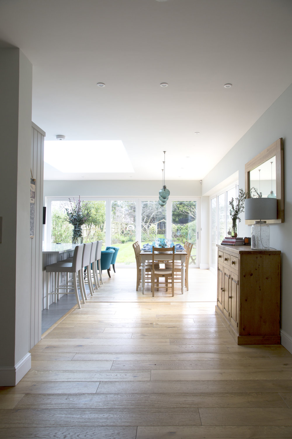 A large and bright shaker kitchen extension in Sevenoaks Kent creates a multi-purpose kitchen and dining space in this family home - Interior Design by Phoebe Oldrey of Smartstyle Interiors