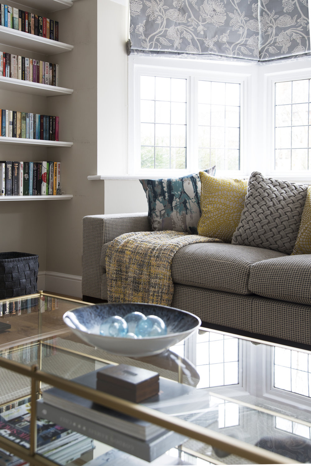 A modern brass coffee table and bespoke roman blinds work well with period features in this arts and crafts home in Sevenoaks Kent - Interior Design by Phoebe Oldrey of Smartstyle Interiors