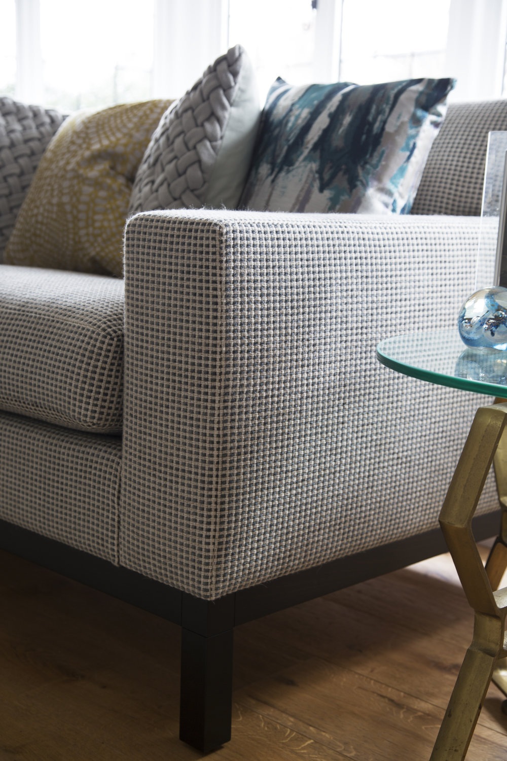 This grey fabric adds depth and texture to this sofa in a classic contemporary family room in Sevenoaks Kent - Interior Design by Phoebe Oldrey of Smartstyle Interiors