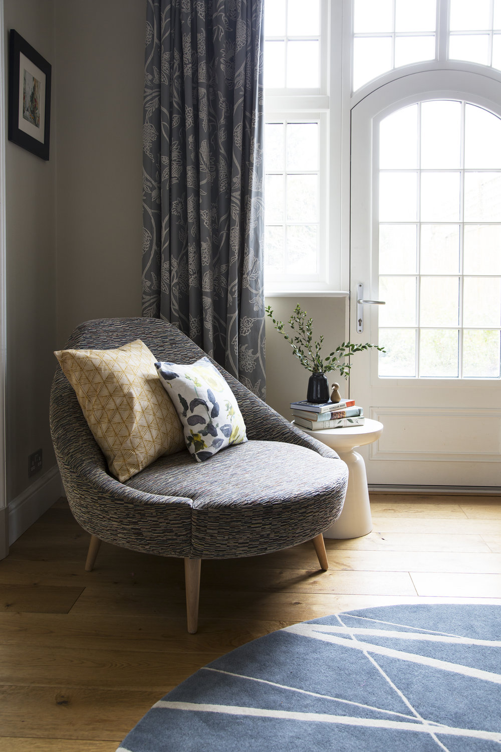 Printed and textured fabrics are used to add visual interest, texture and depth in this sitting room in Sevenoaks Kent - Interior Design by Phoebe Oldrey of Smartstyle Interiors