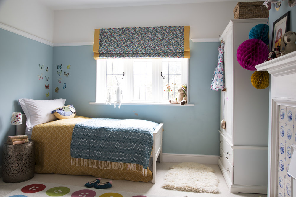 Yellows and blues pop in a little girl's bedroom in Sevenoaks Kent - Interior Design by Phoebe Oldrey of Smartstyle Interiors