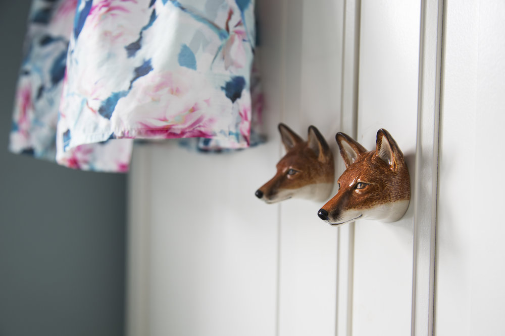 Playful fox head knobs on a wardrobe in a little girl's bedroom in Sevenoaks Kent - Interior Design by Phoebe Oldrey of Smartstyle Interiors