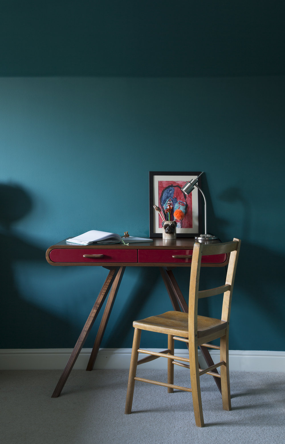 Dark Teal Walls make this teenagers room dramatic