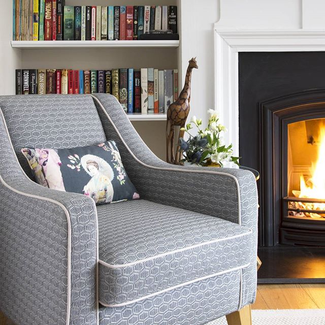 A roaring fire and a great book, that's what makes a bit of time in a good chair perfect.  #holisticinteriordesign #fireplace #livingroom
