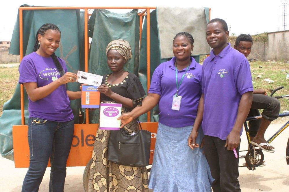 Customer receiving her wecycle reward.JPG