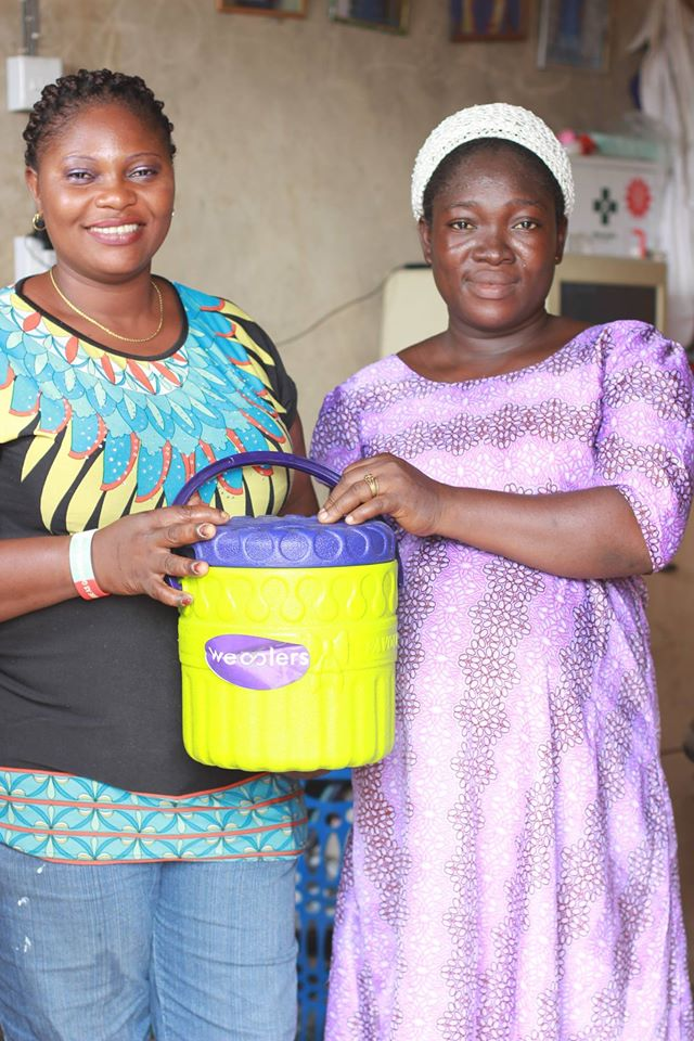 Alabi Monsurat receiving her wecycle reward.jpg