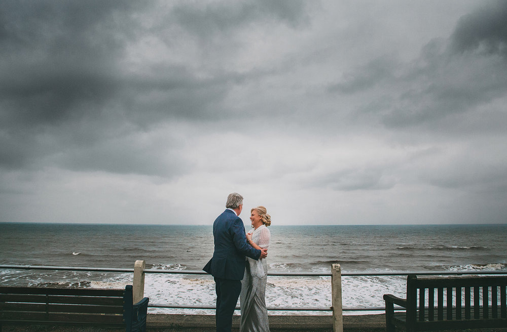 Penny & Mike go for a bracing walk after their wedding ceremony - Cromer