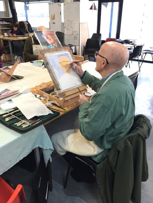 Tom Mellors painting his self portrait.