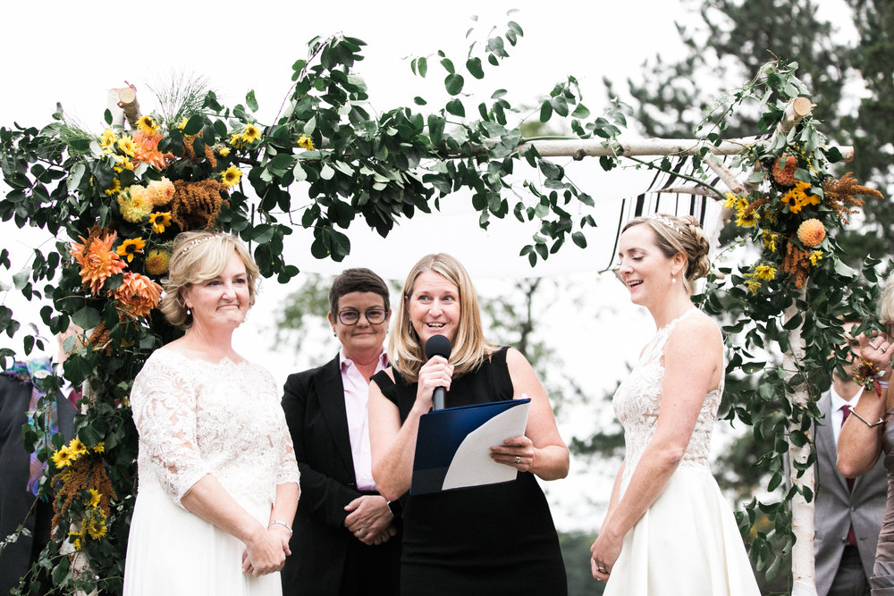 The couple's family built their chuppah, which we decorated with Sharon's favorite, sunflowers. Photo by Brigham and Co Photography.