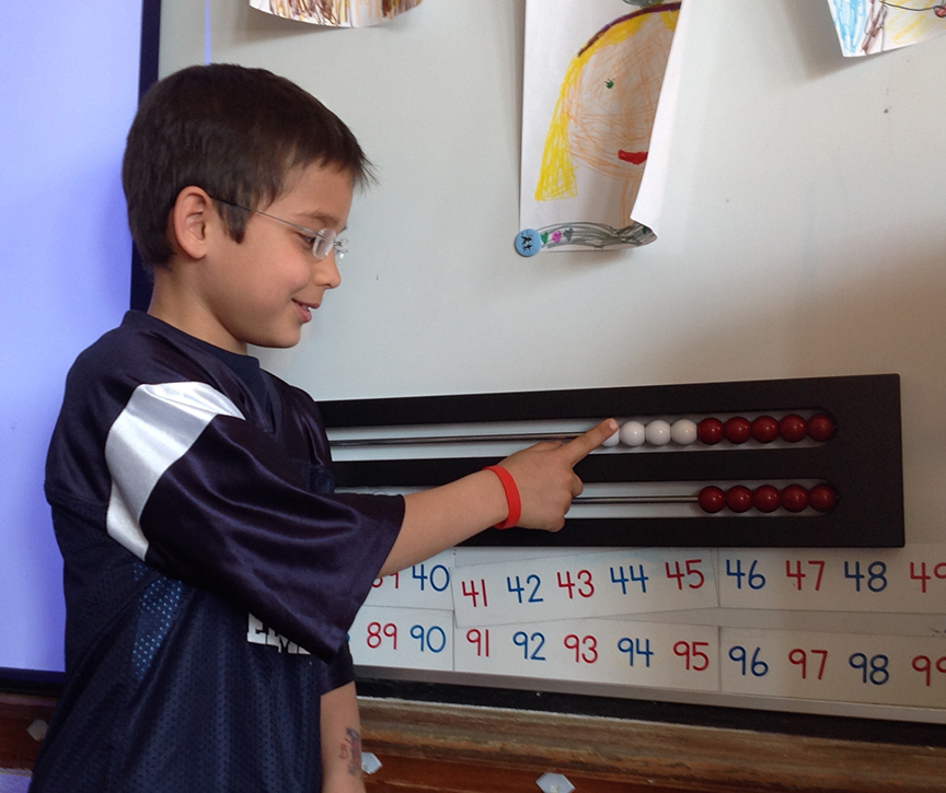 A student uses the Math Racks.