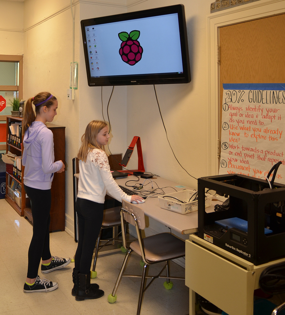 Students prepare to use the 3-D printer in the Maker Space.