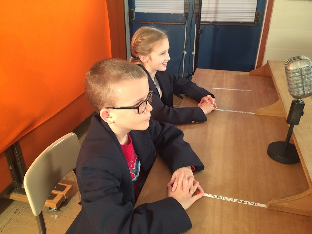 Hubbard Woods students co-anchor the morning's broadcast.