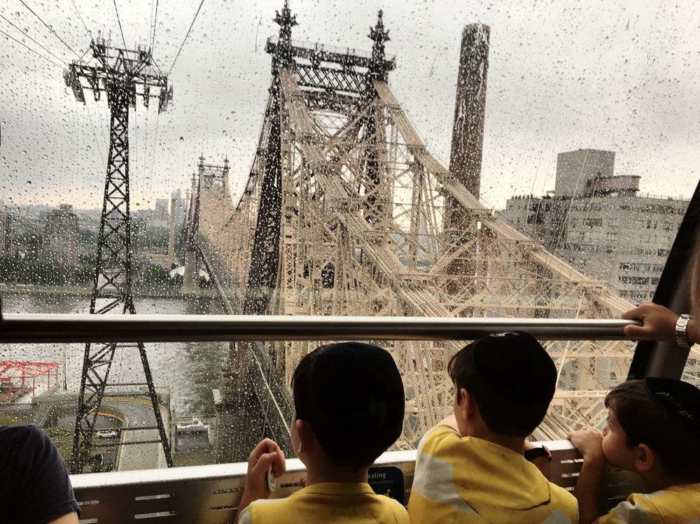 Children ride the Roosevelt Island Tramway. New York, NY