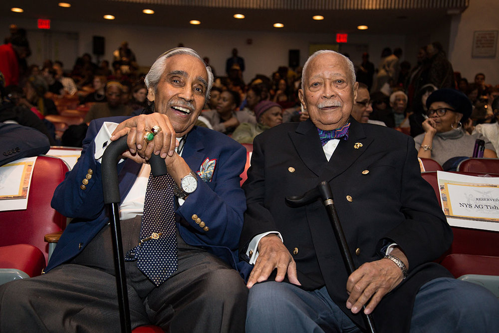 Former Congressman Charles B. Rangle and Former Mayor of New York David D. Dinkins arrive and take their seats at the venue.