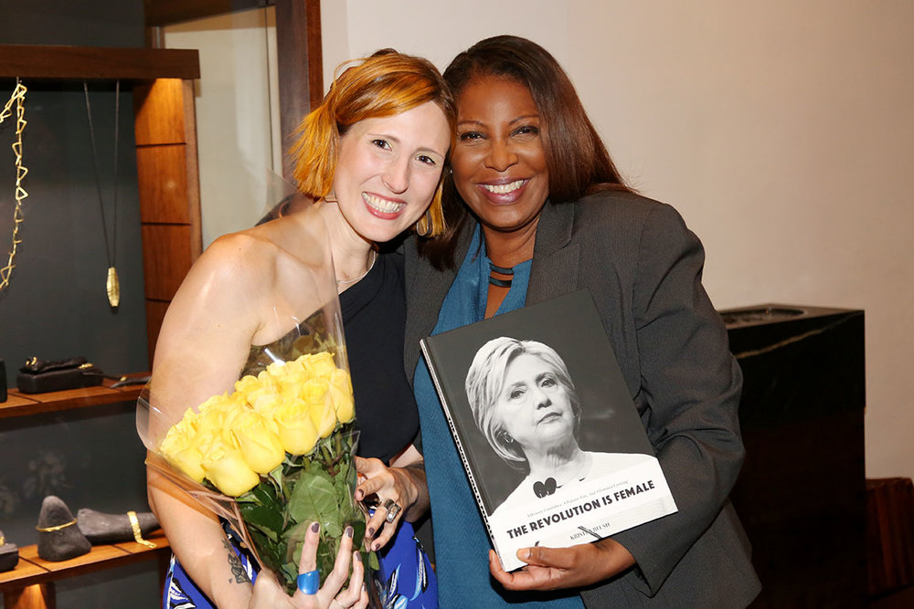 Kristen Blush and New York Attorney General Letitia (Tish) James pose with a copy of The Revolution Is Female at Blush's book signing event.