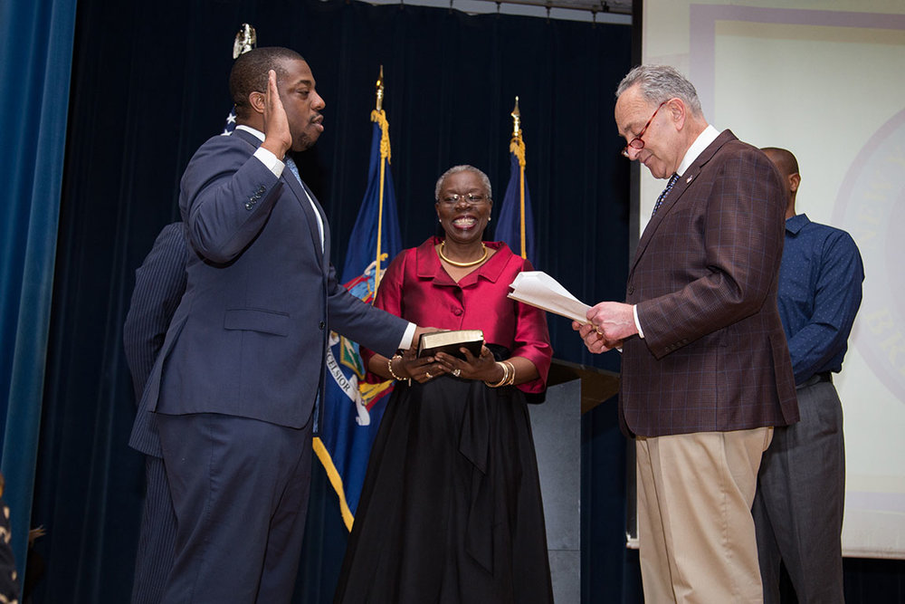 Senator Brian Benjamin is swore into office by U.S. Senator Chuck Schumer, and his mother.