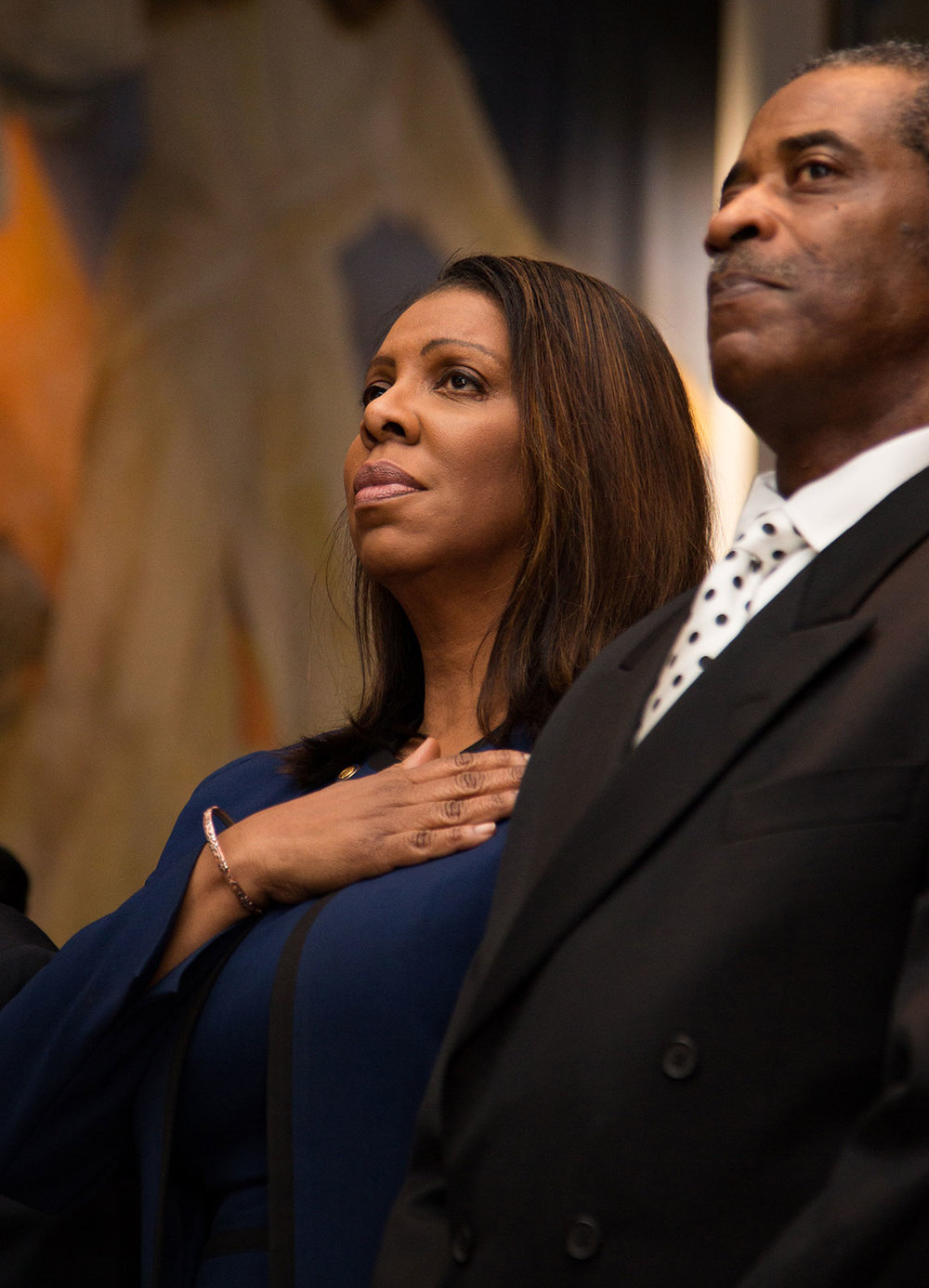 New York Attorney General Letitia James places her hand on her heart during the presentation of colors ceremony.
