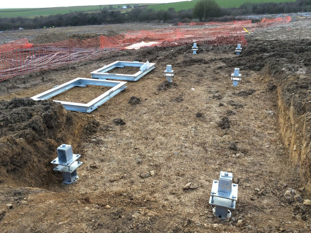 - 14 No Screw piles. 6 No with transition steel to support a 40ft package plant container and 4 no piles for 2 no ring beams to support transformers and oil bunds.