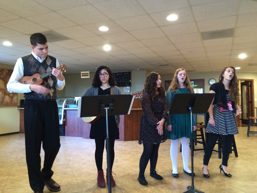 Voice Students sing carols before Christmas Eve Services at Bethel Chehalis.